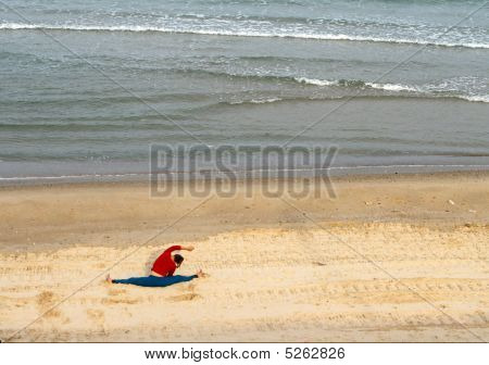 Woman Doing Gymnastics On The Sea Beach