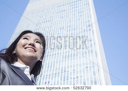 Portrait of young businesswoman by Chinas world trade center building in Beijing