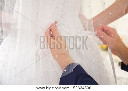 Newlywed Young Man Undressing Bride