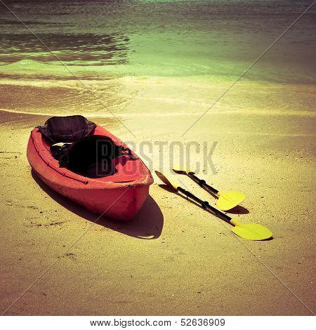 Red canoe boat at ocean coastline. Thailand