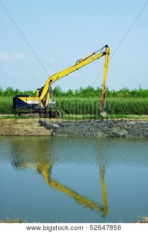 Excavator Dredging The Canal