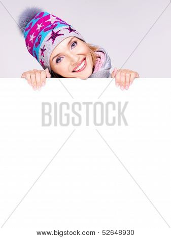 Happy Woman In Winter Outerwear Over White Banner