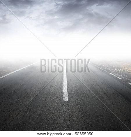 Empty Foggy Rural Asphalt Highway Perspective With White Line