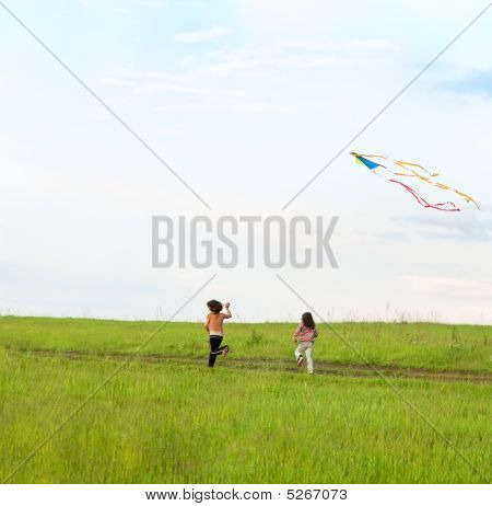 Two Little Girls Fly A Kite