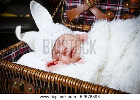Sleeping Baby In A Suit Of A Rabbit