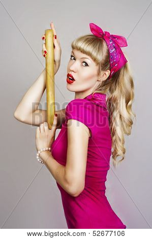 Girl Erotically Holds A Rolling Pin