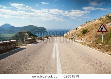 Dividing Line And Right Turn Sign On The Coastal Mountain Highway In Montenegro