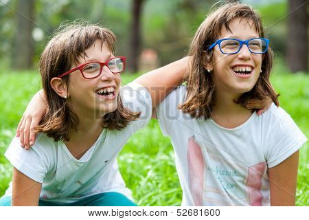 Two Young Disabled Kids Laughing Outdoors.