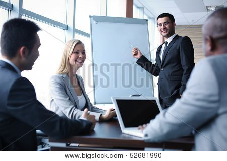 Image of business people interacting at seminar