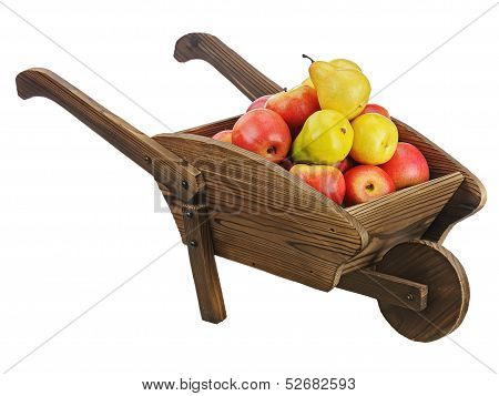 Red Apples And Pears On Wooden Pushcart Isolated On White Background.