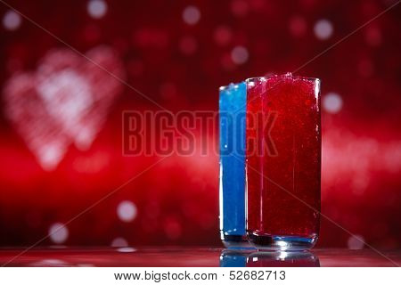 slush ice in glasses, red and blue on glitter star background