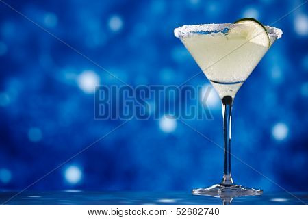 margarita  cocktail on star glitter dark blue background, shallow dof