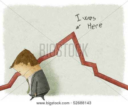 Sad businessman standing near graphic