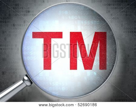 Law concept: Trademark with optical glass on digital background