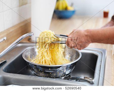 pile of fresh pasta in strainer