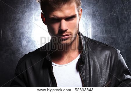 killer look of a young macho man in leather jacket