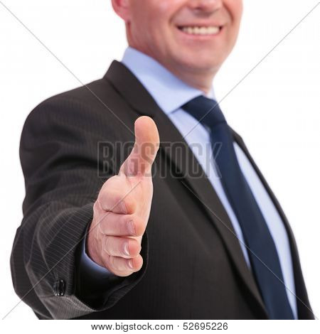 closeup of a business man offering a handshake with a smile on his face. on a white background