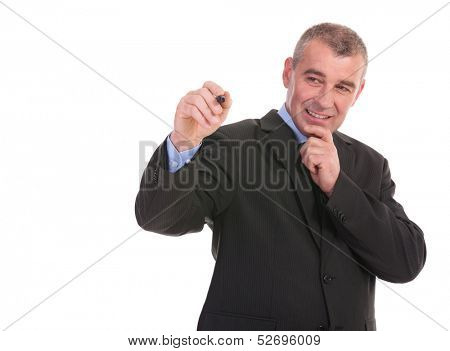 business man writing on an imaginary screen while holding a hand at his chin. on a white background