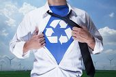 foto of button down shirt  - Businessman with open short revealing shirt with recycling symbol underneath - JPG