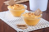 stock photo of crisps  - Pumpkin dip in small glass cups with bread crisps on background - JPG