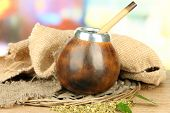 foto of calabash  - Calabash and bombilla with yerba mate on wooden table  - JPG