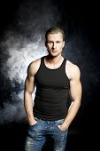 foto of stripper  - Handsome muscular sexy young man in black t - JPG
