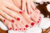 picture of pedicure  - Closeup photo of a beautiful female feet at spa salon on pedicure procedure - JPG