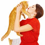 Beautiful brunette girl kissing a red cat