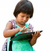 Cute Native American Girl Typing On Tablet.