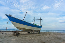 stock photo of carron  - Traditional Fisherman Wooden Boat with blue skies - JPG