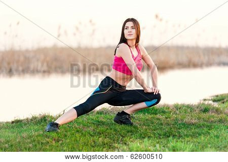 Beautiful woman working out in nature