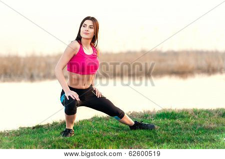 Portrait of woman training at sunset