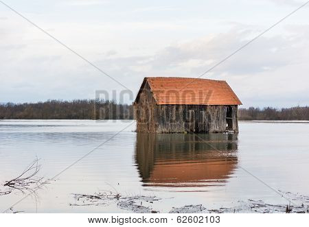 Barn Surrounded With Water
