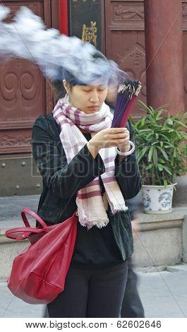 Shanghai.china - Nov. 15.2013. Woman In Buddhist Temple