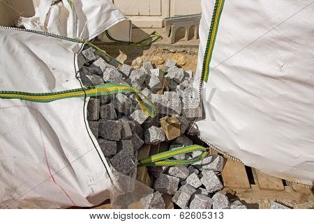 Bags of granite blocks, paved for the road