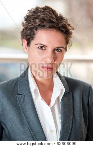 Portrait of frowning businesswoman