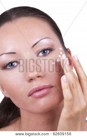 Woman Applying Cream For Eyes Area