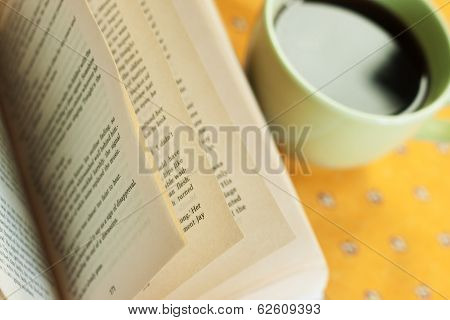 Reading with cup of coffee