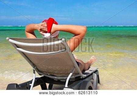 Santa Rest On Chaise Longue On Tropical Beach