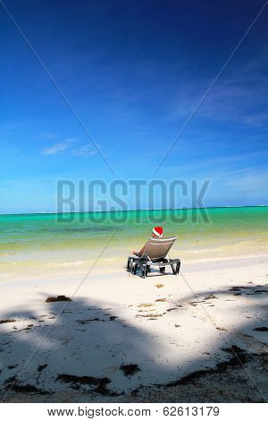 Man In Santa Hat Resting On Chaise Longue