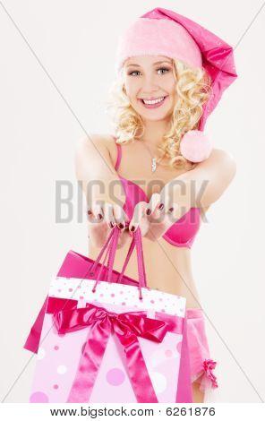 Santa Helfer mit rosa Einkaufstaschen