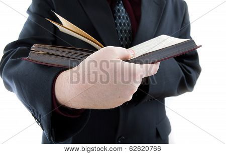 Man Holding An Open Book