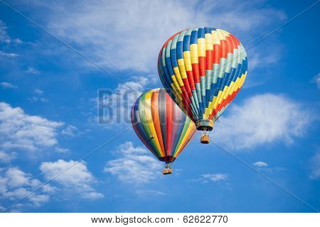 Beautiful Hot Air Balloons Against a Deep Blue Sky and Clouds.