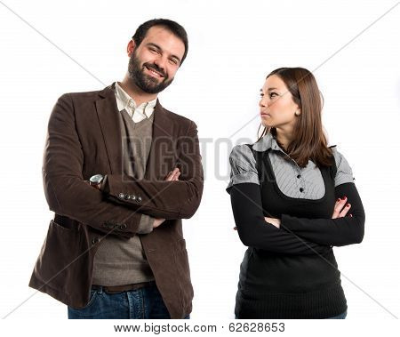 Couple With Their Arms Crossed Over Isolated Background