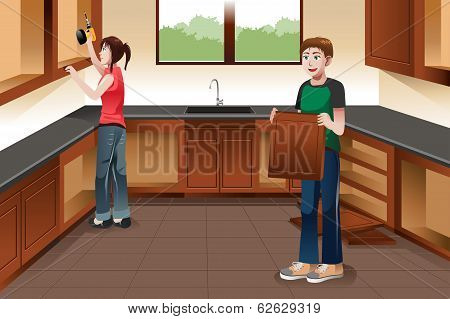 Young Couple Installing Kitchen Cabinets