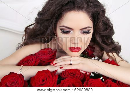 Beautiful Brunette Woman With Red Roses Bouquet, Valentines Day. Red Lips And Manicured Nails.