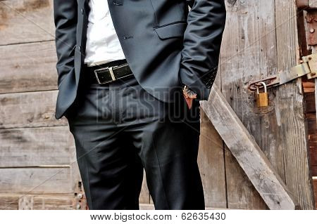 Elegant man with suit and watch