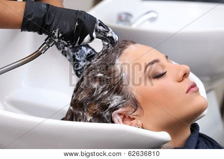 Hairdresser salon. Woman during hair wash