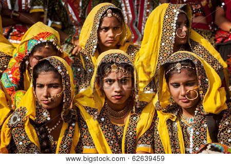 PUSHKAR, INDIA - NOVEMBER 21, 2012: Unidentified Rajasthani girls in traditional outfits prepare for dance perfomance at annual camel fair  Pushkar Mela in Pushkar, Rajasthan, India