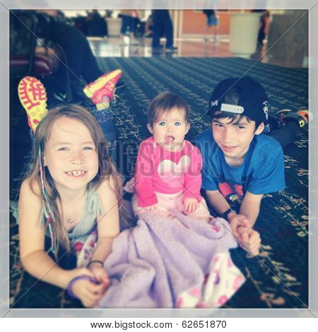 Three children waiting at airport - instagram effect